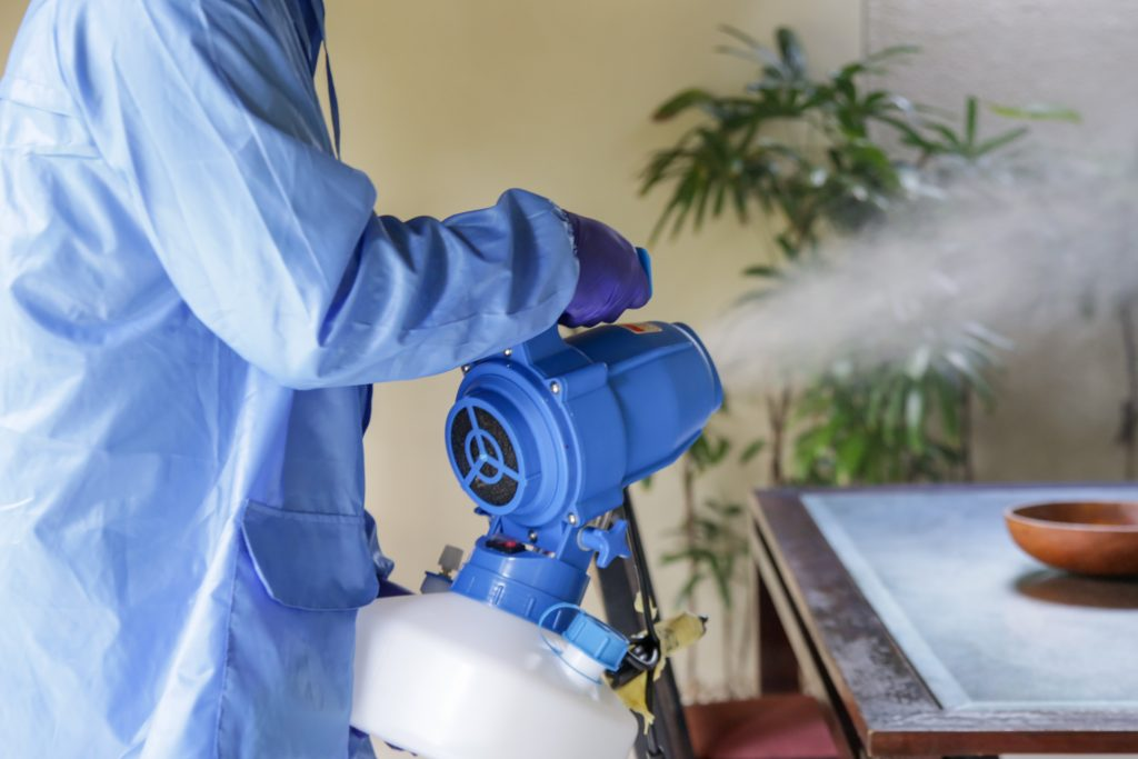 man Fogging with disinfectant